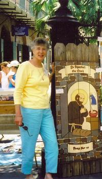 Paulette Allen, Illustrator for Sebastian the Dragonfly and Sabina the Beach Fly.  This photograph includes one of her Saints on wood.